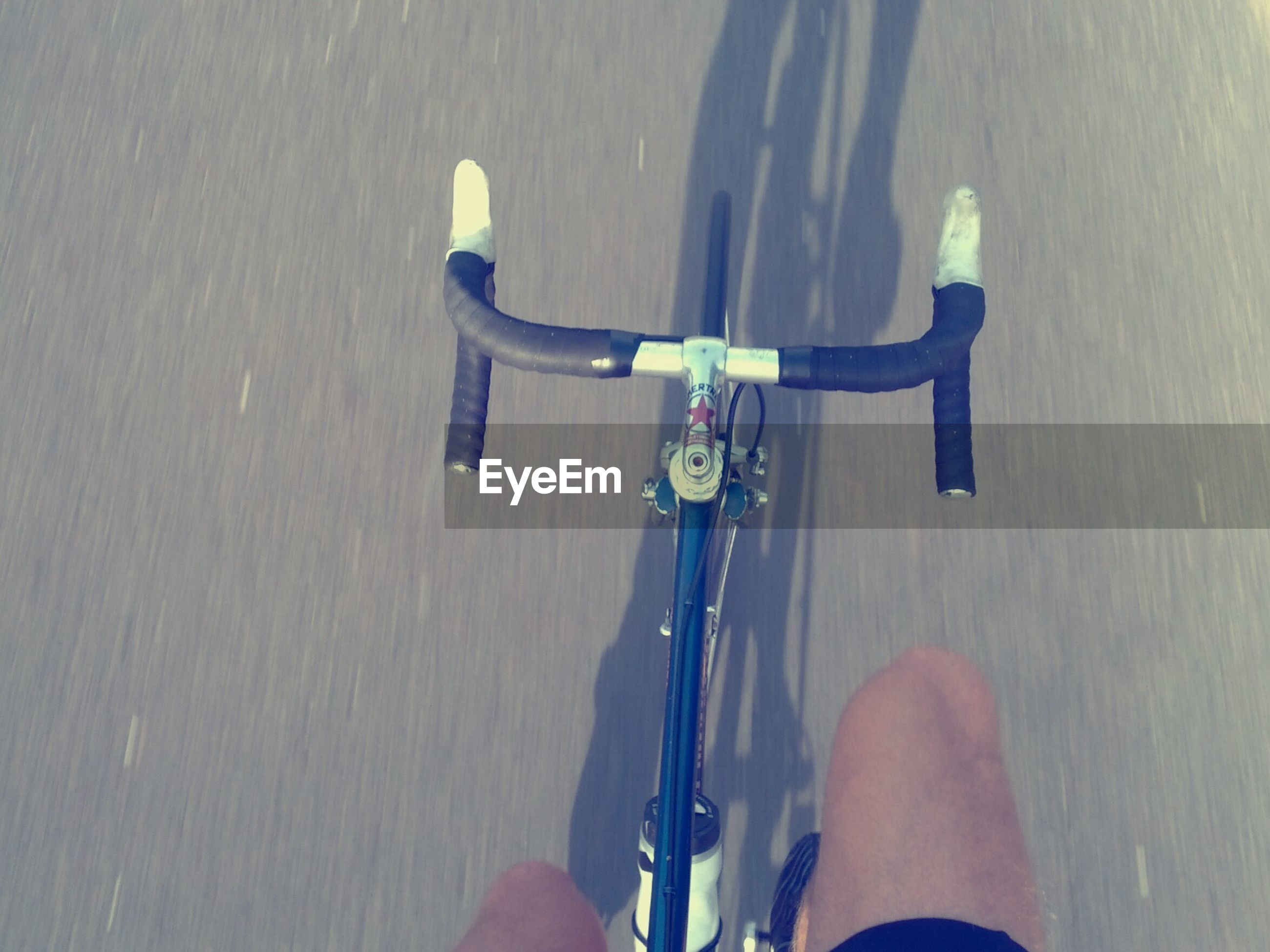 Cropped image of man cycling without holding handlebars