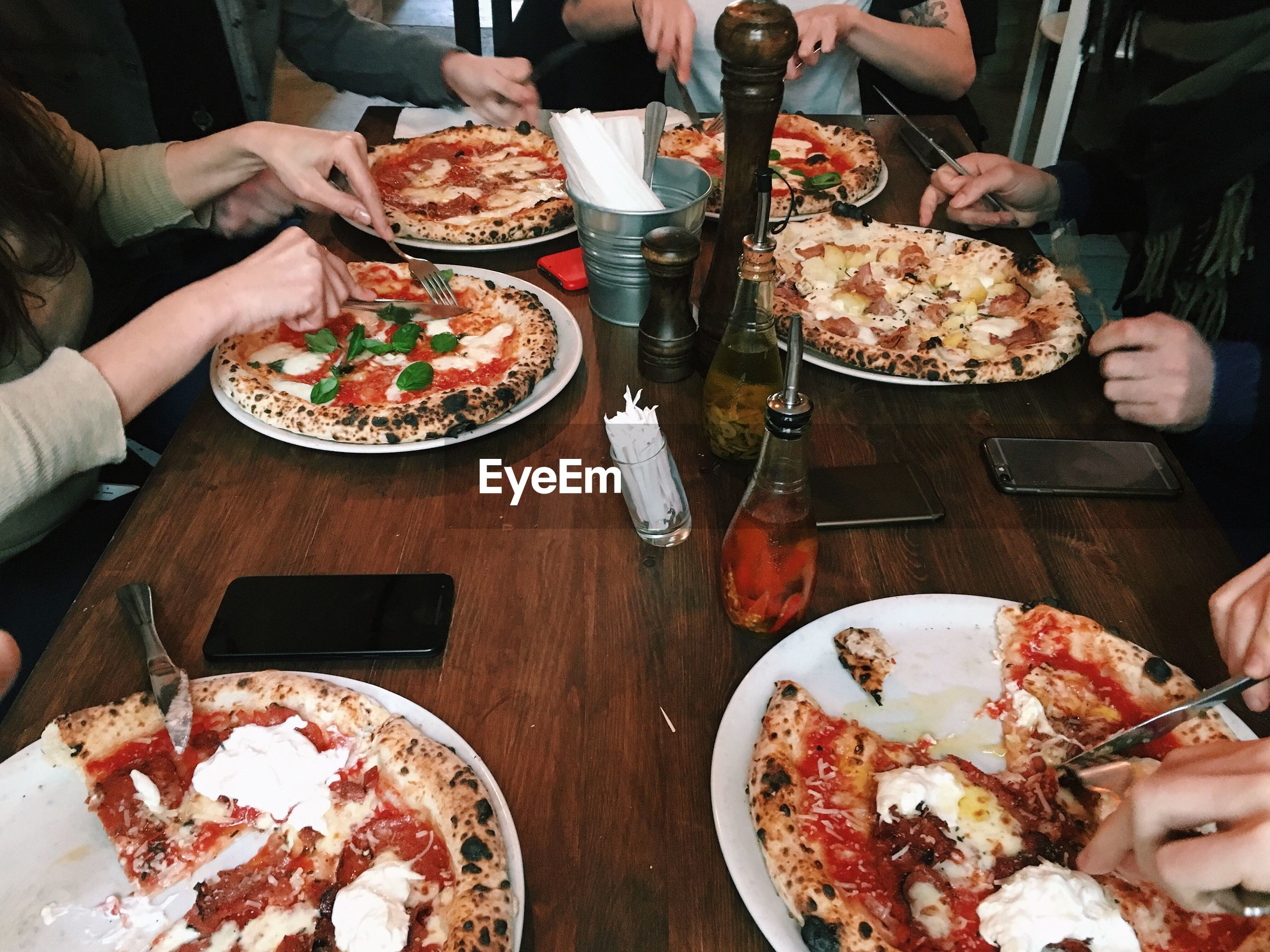 High angle view of friends eating pizza