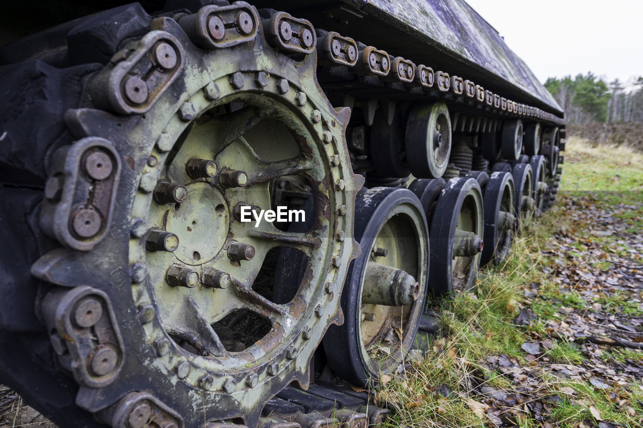 Old abandoned tank on field
