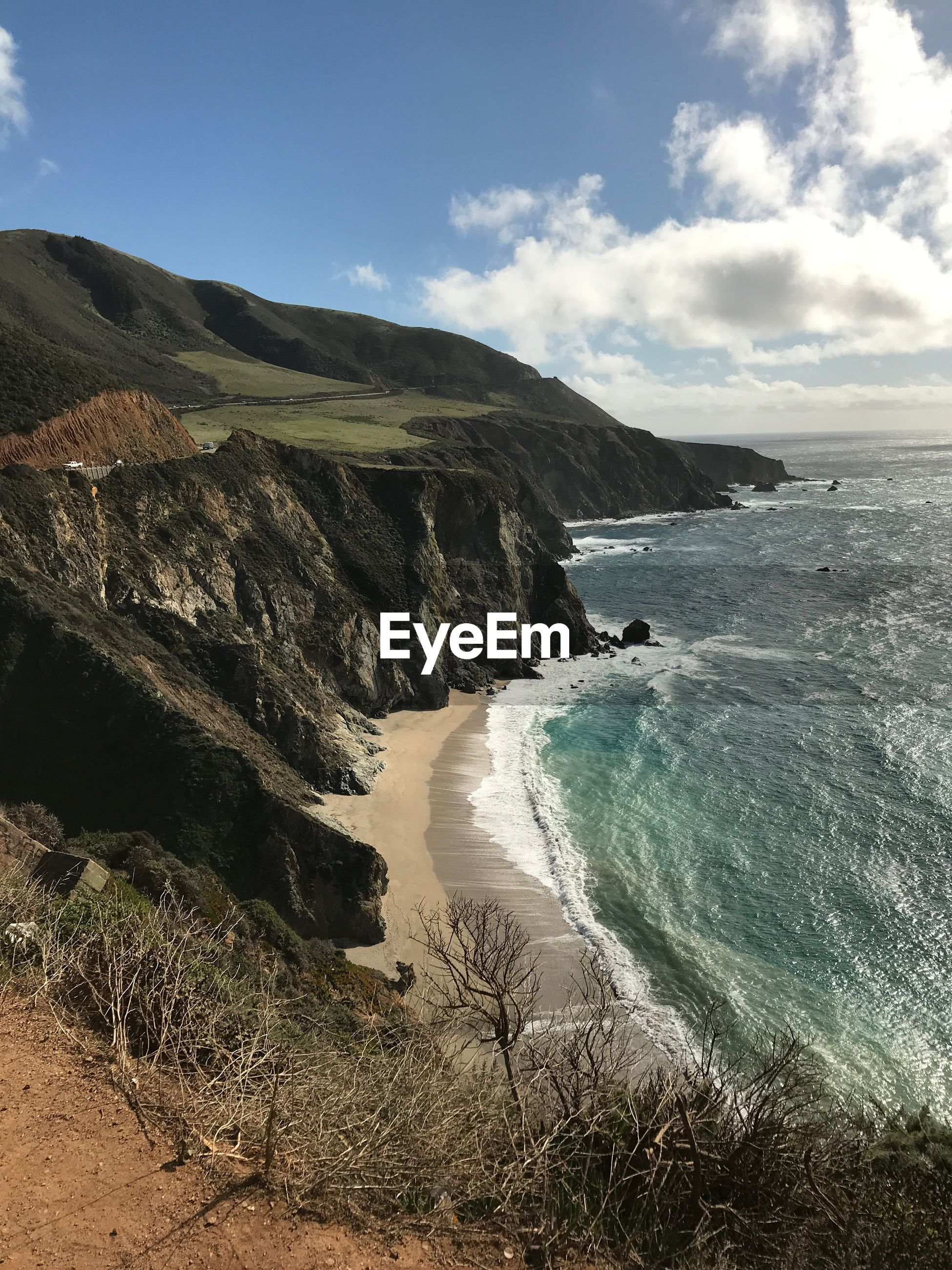 SCENIC VIEW OF BEACH AND MOUNTAIN AGAINST SKY