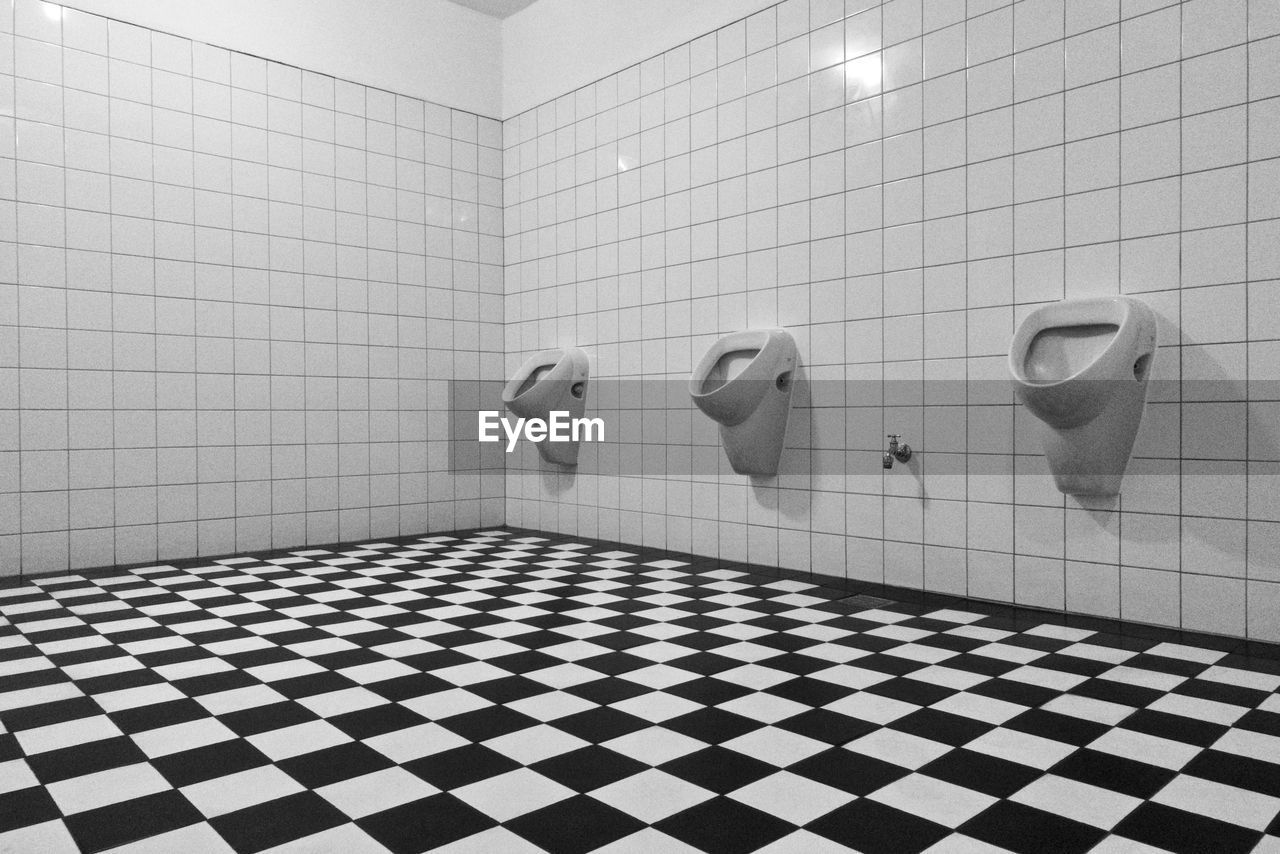 tile, flooring, bathroom, indoors, tiled floor, toilet, hygiene, domestic bathroom, checked pattern, domestic room, wall - building feature, no people, home, pattern, public building, urinal, public restroom, shape, design, convenience, clean