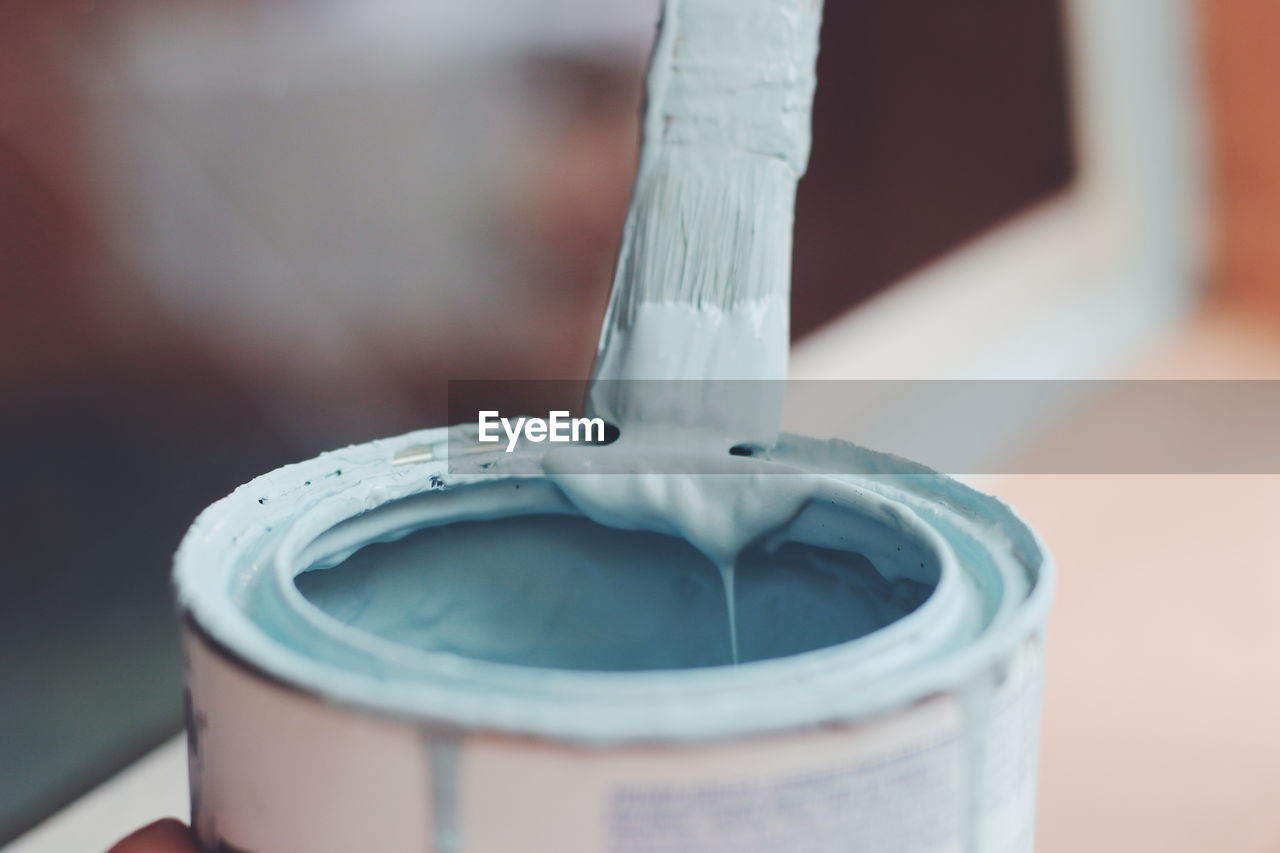 Close up of paint brush in can
