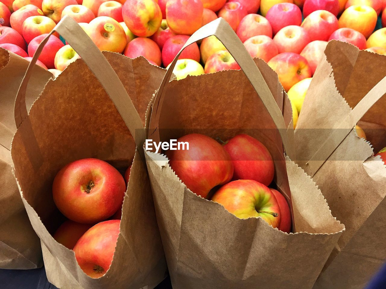 food and drink, food, freshness, healthy eating, fruit, still life, wellbeing, paper bag, no people, large group of objects, container, high angle view, paper, bag, variation, choice, indoors, retail, abundance, red, box - container, ripe