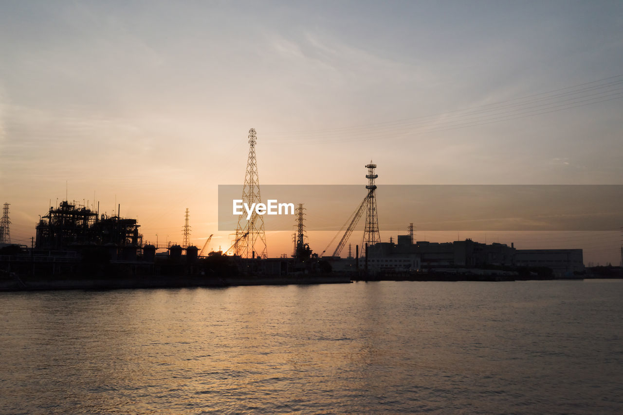 View of commercial dock against sky during sunset