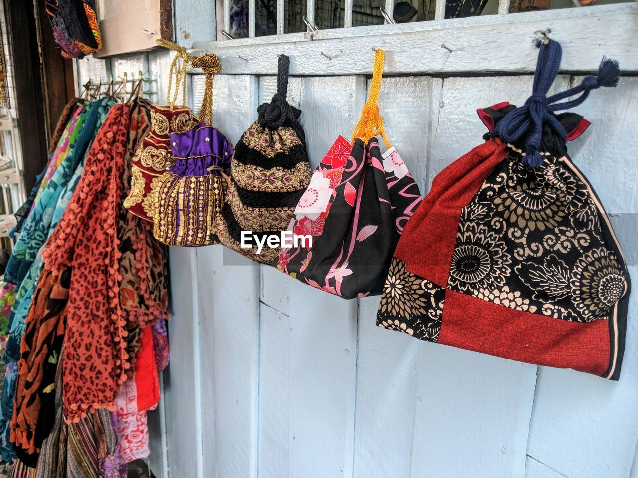 hanging, retail, no people, clothing, choice, market, variation, retail display, textile, day, for sale, market stall, outdoors, small business, wall - building feature, side by side, multi colored, architecture, drying
