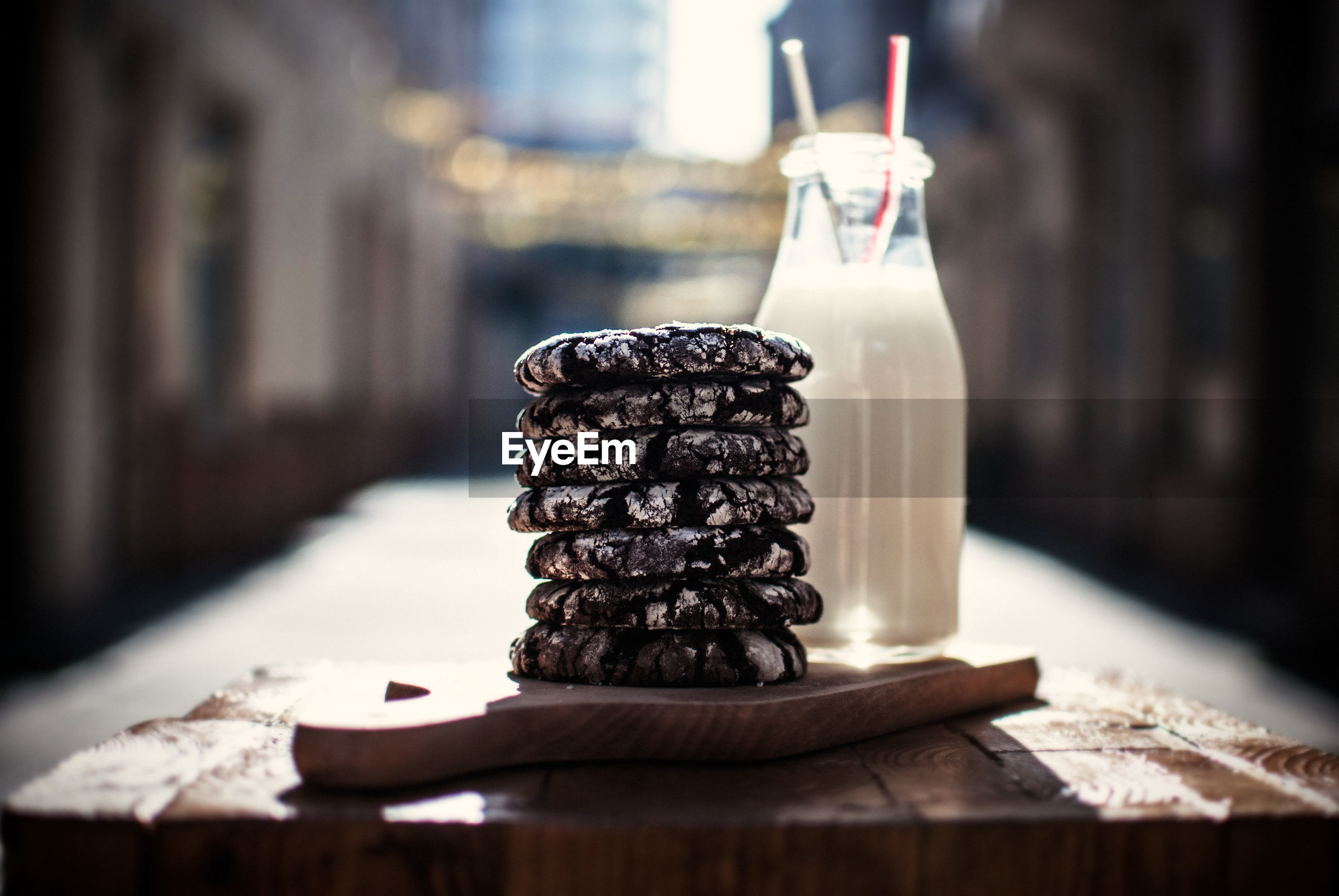 Stack of cookies with milk served on table