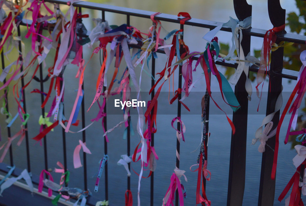 hanging, no people, outdoors, day, ribbon, multi colored, close-up, hope