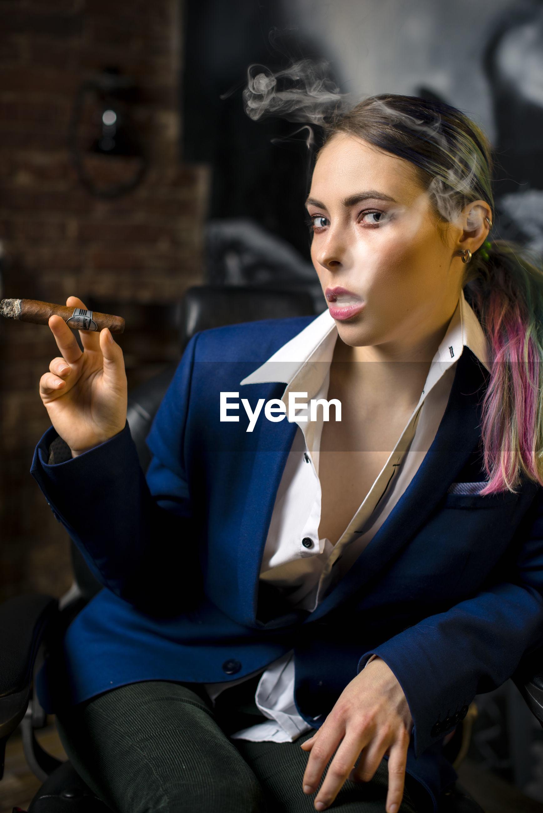 Portrait of woman smoking cigar