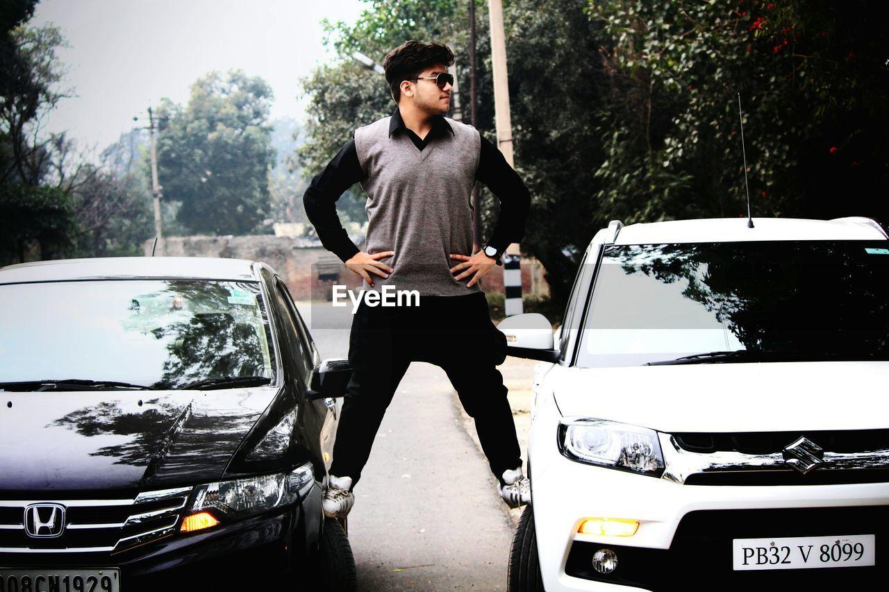 MAN STANDING IN CAR