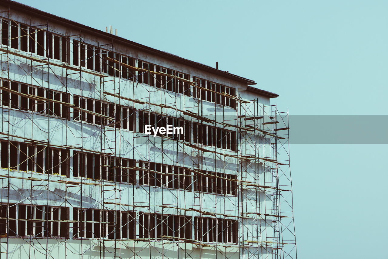 Scaffoldings On Building Against Sky At Construction Site