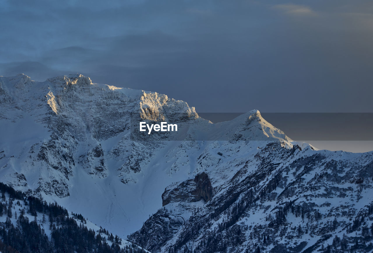 mountain, beauty in nature, winter, scenics - nature, snow, cold temperature, sky, tranquility, mountain range, tranquil scene, no people, day, nature, cloud - sky, non-urban scene, idyllic, environment, mountain peak, snowcapped mountain, outdoors, formation