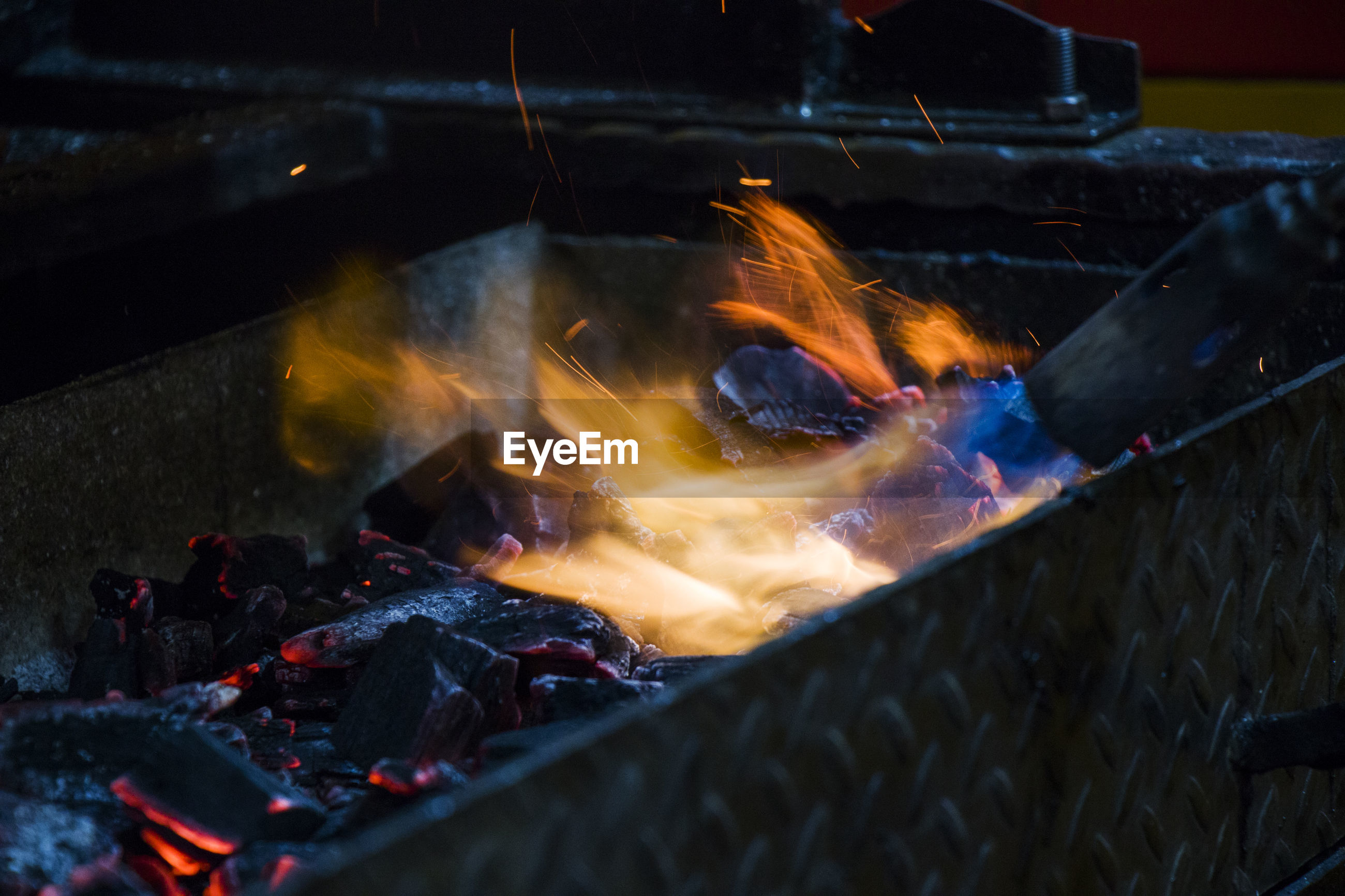 High angle view of bonfire on barbecue grill, gas fire