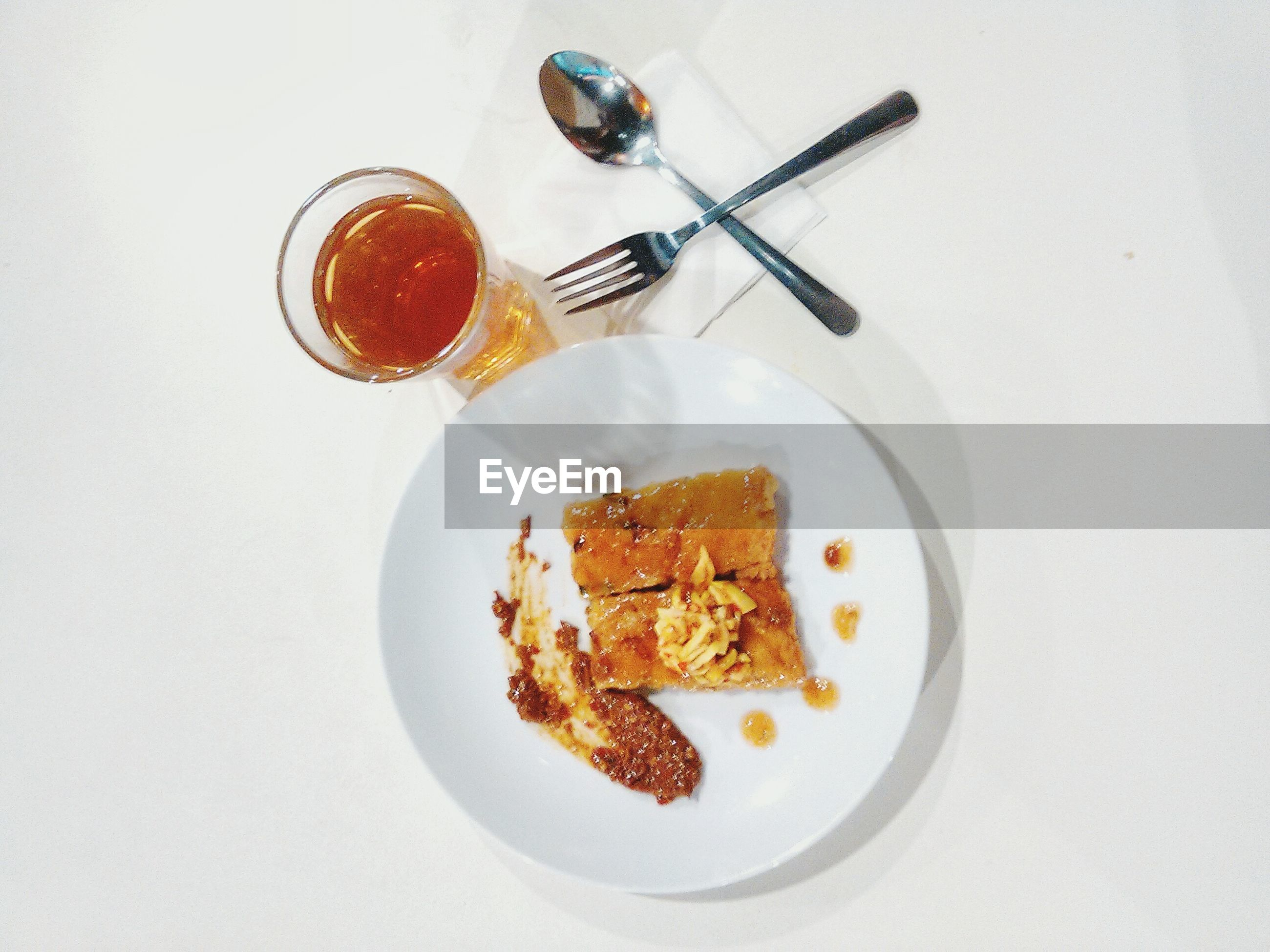 Directly above view of food and drink on white background