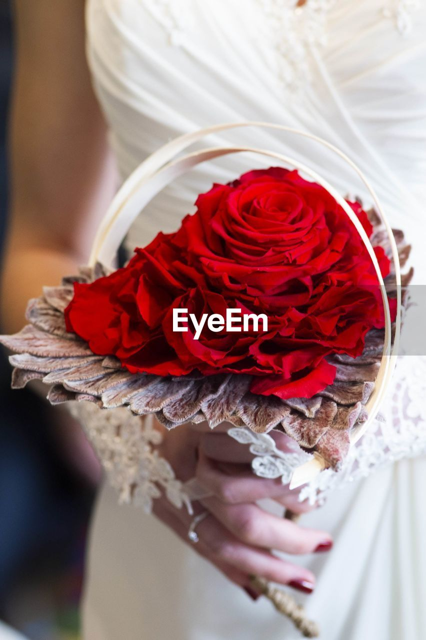 holding, flower, wedding, bride, red, hand, newlywed, real people, celebration, one person, event, flowering plant, human hand, rose, rose - flower, flower arrangement, beauty in nature, human body part, life events, women, bouquet, wedding ceremony, flower head