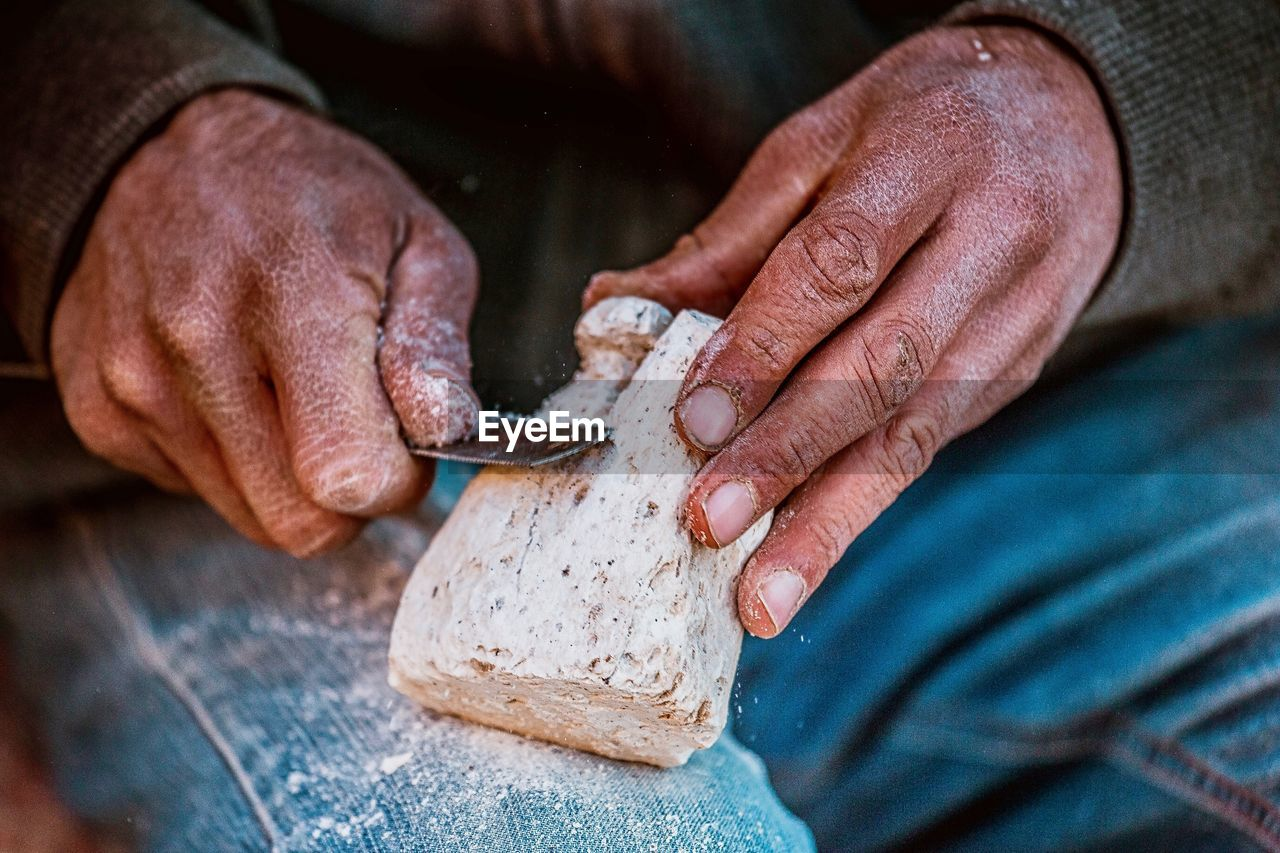 craftsperson, carving - craft activity, working, real people, work tool, one person, occupation, skill, indoors, holding, wood - material, workshop, men, human hand, human body part, hand tool, close-up, day, adult, people
