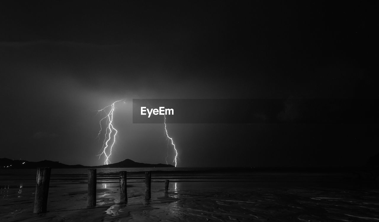 lightning, thunderstorm, power in nature, water, sky, forked lightning, weather, cloud - sky, storm cloud, waterfront, sea, nature, illuminated, storm, no people, night, outdoors, beauty in nature, electricity, scenics, horizon over water