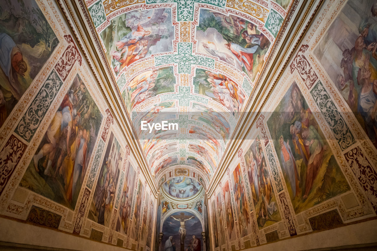 architecture, ceiling, religion, mural, indoors, place of worship, built structure, low angle view, history, belief, the past, spirituality, travel destinations, building, human representation, fresco, art and craft, no people, arch, architectural column, architecture and art, ornate