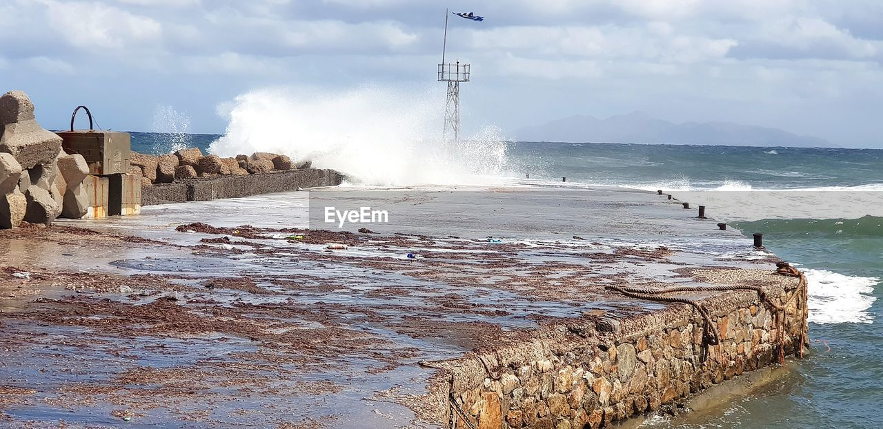 water, sea, sky, motion, nature, cloud - sky, day, beauty in nature, beach, power in nature, architecture, rock, scenics - nature, land, splashing, power, no people, solid, built structure, outdoors, breaking