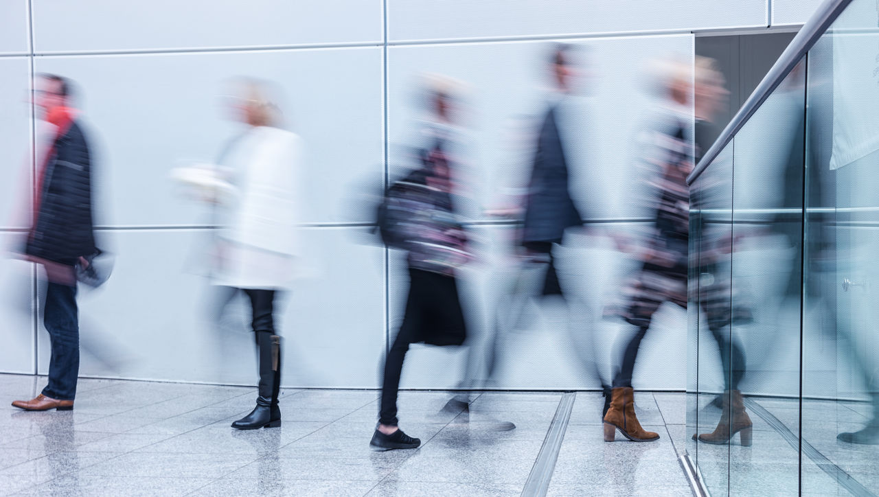 Blurred Motion Of People Walking In Office