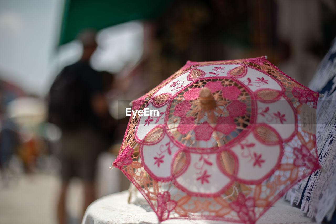 Close-up of figurine umbrella for sale at market