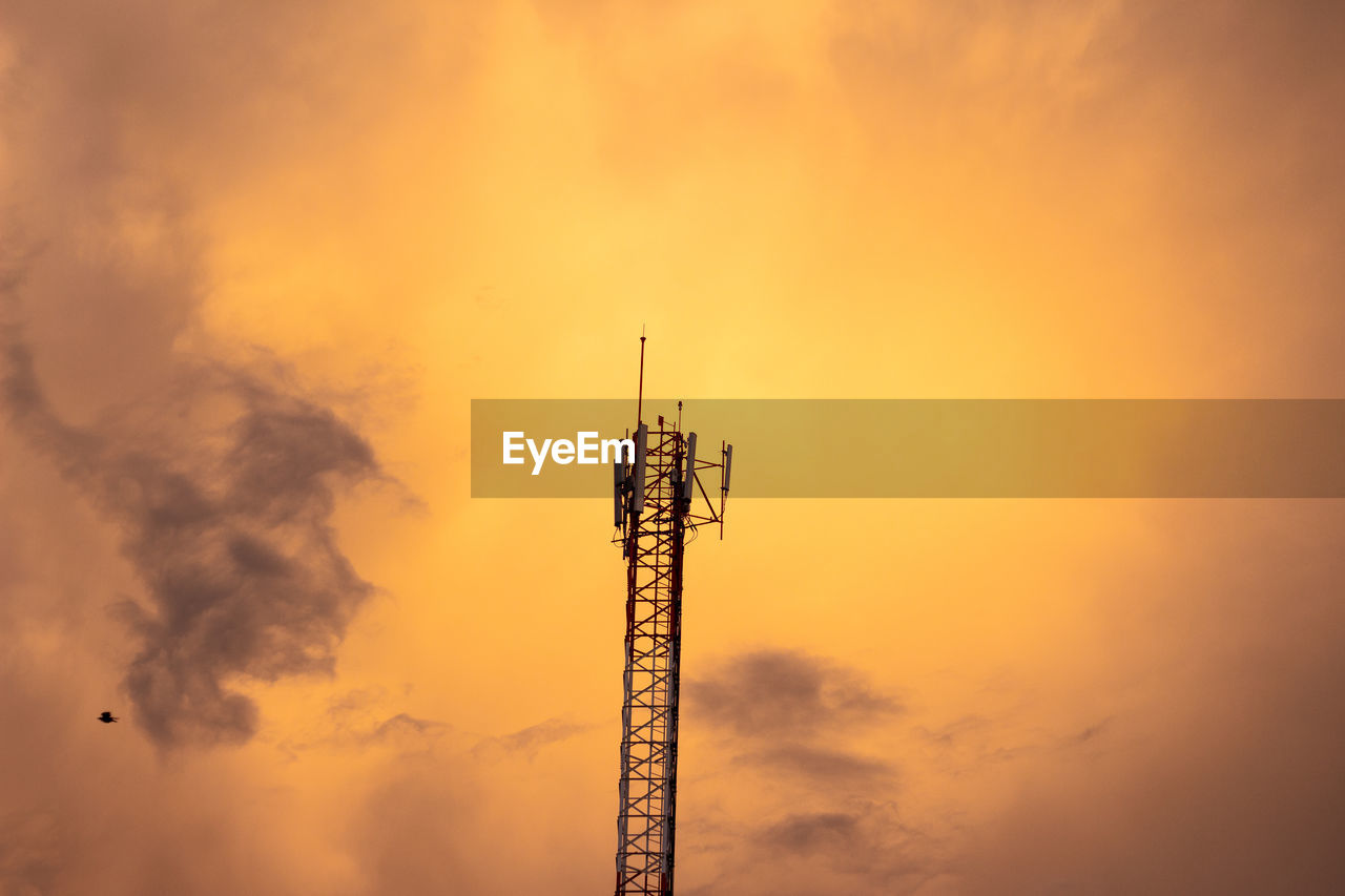sky, sunset, technology, broadcasting, tower, communication, wireless technology, connection, orange color, antenna - aerial, no people, cloud - sky, architecture, global communications, low angle view, built structure, silhouette, nature, satellite, outdoors, tall - high