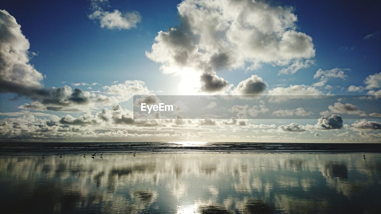 reflection, sky, nature, scenics, beauty in nature, water, tranquility, cloud - sky, tranquil scene, no people, outdoors, sea, day, landscape