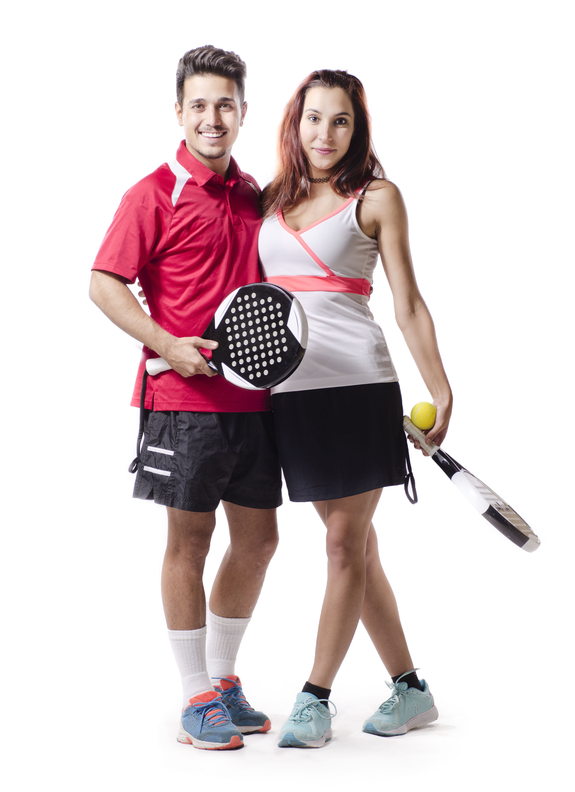 Portrait of paddle tennis players standing against white background