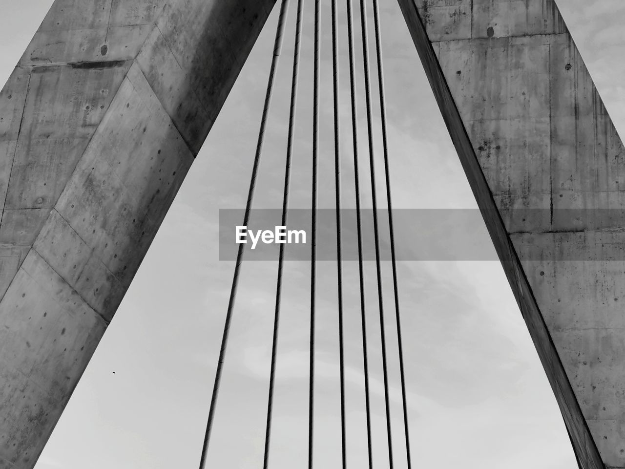LOW ANGLE VIEW OF BRIDGE CABLES AGAINST SKY
