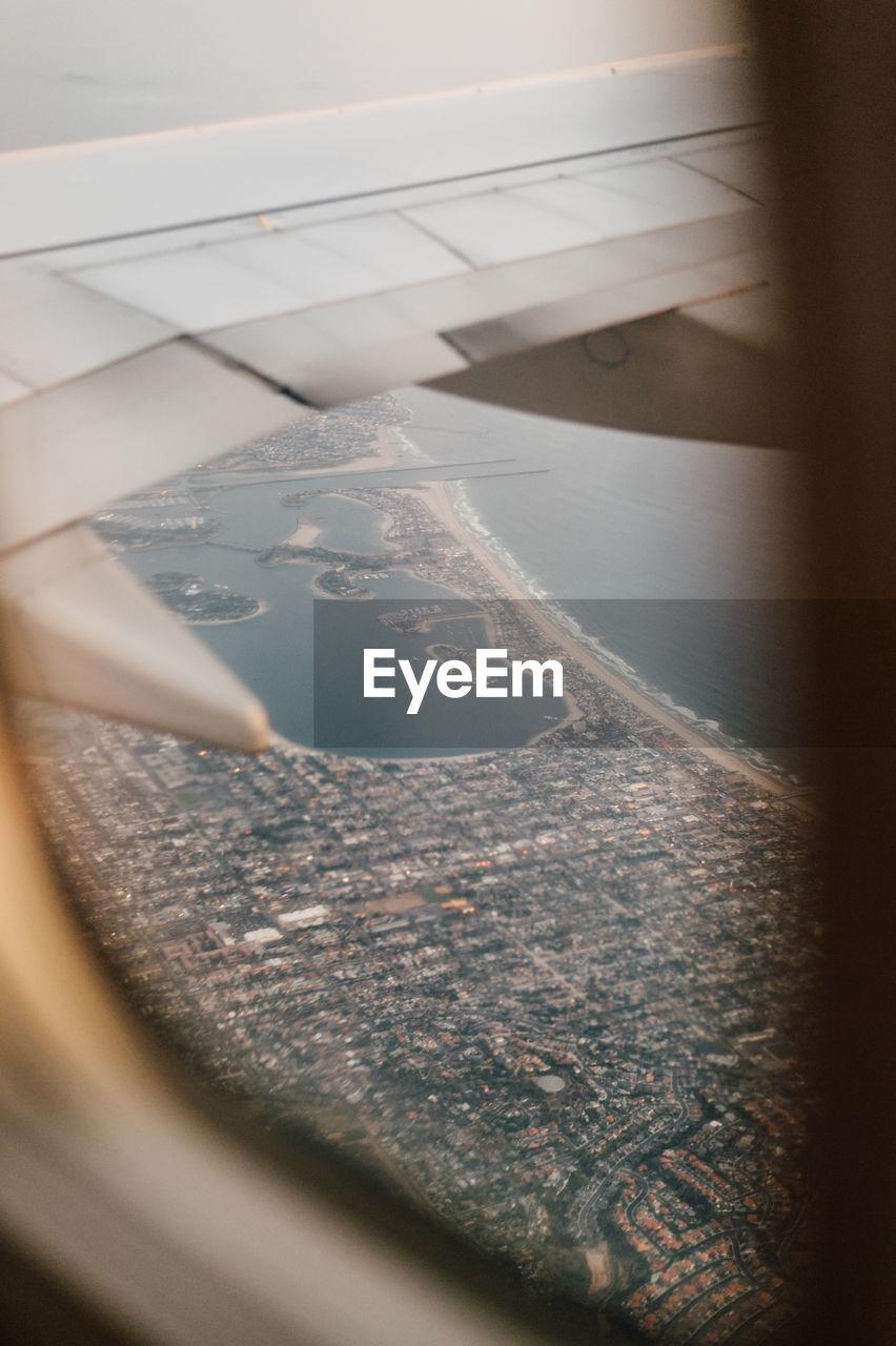Cityscape seen through airplane window