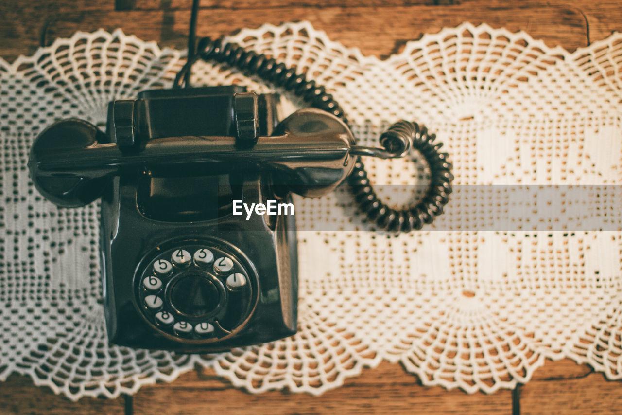 Close-up of vintage landline phone on table