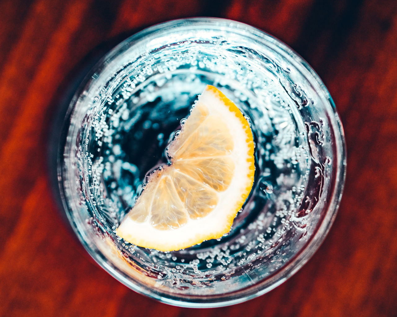 Directly above shot of lemon in glass of water