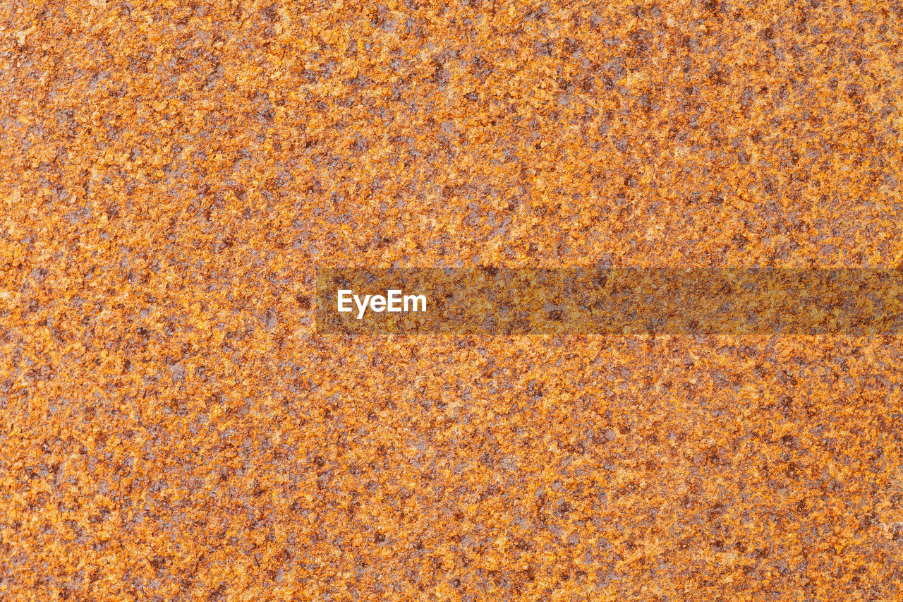 backgrounds, full frame, textured, pattern, close-up, no people, orange color, nature, copy space, yellow, outdoors, directly above, abstract, extreme close-up, day, rough, architecture, land, material, orange