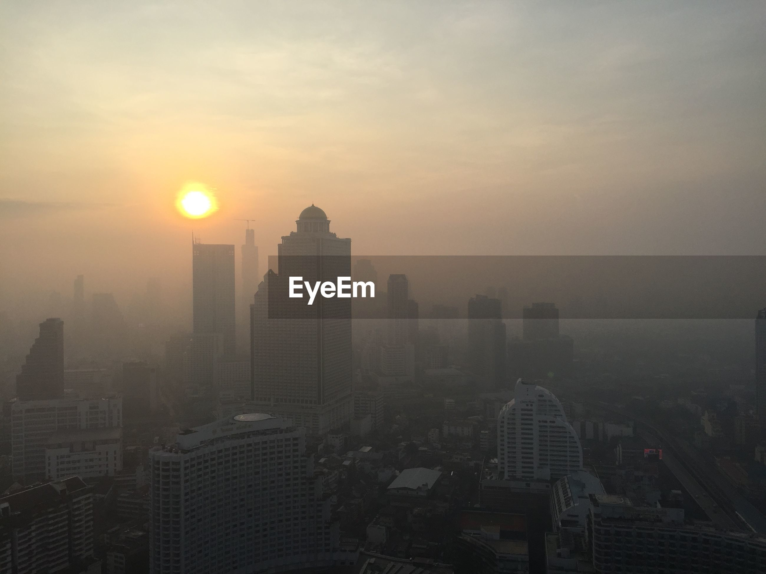 High angle shot of cityscape at sunset
