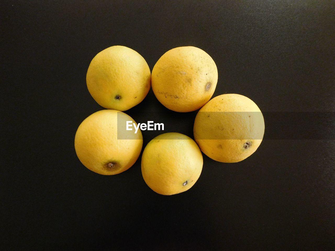 Lemons on black background