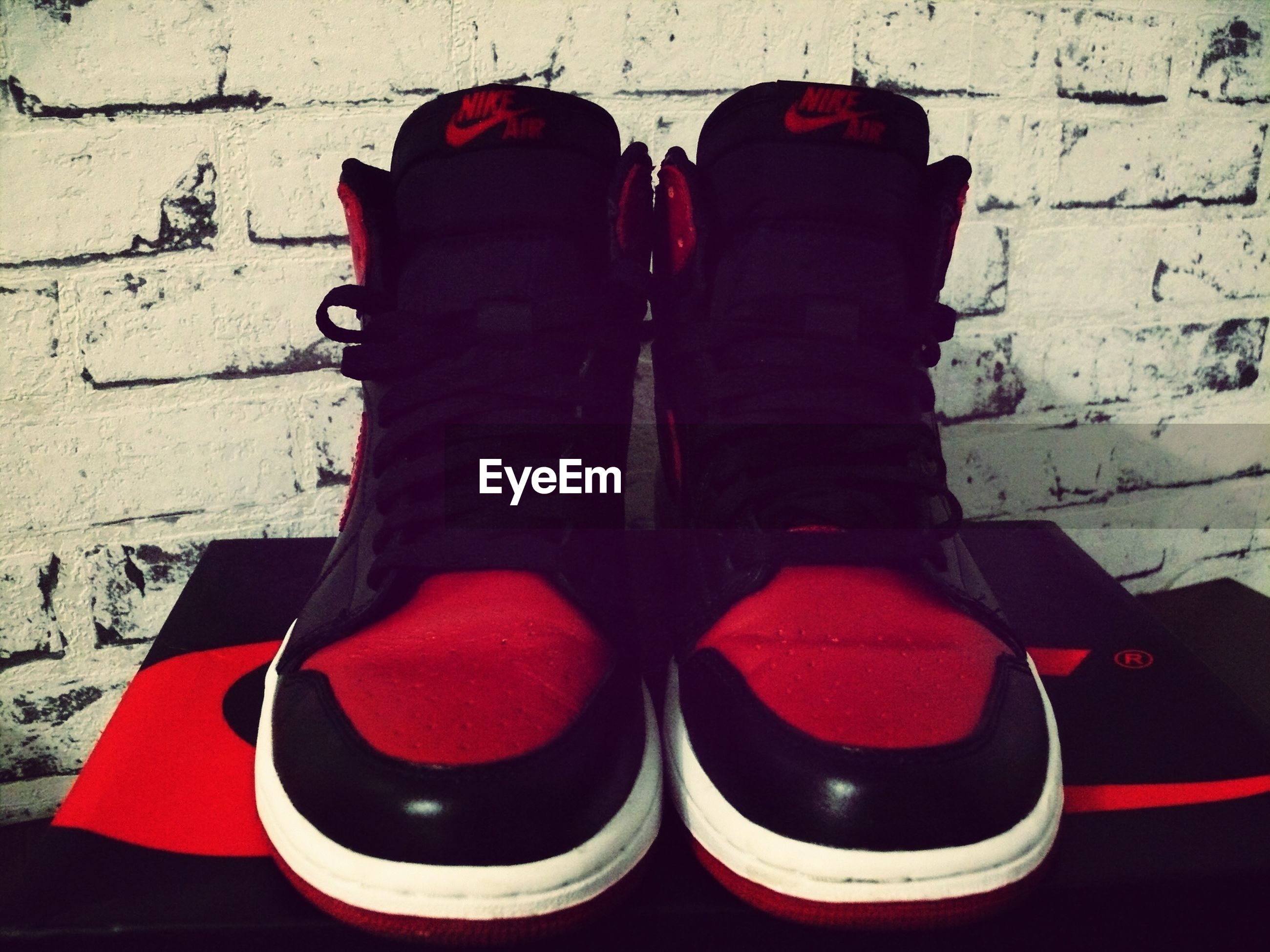 shoe, red, low section, person, footwear, standing, fashion, pair, clothing, indoors, lifestyles, sitting, wall - building feature, high angle view, day, canvas shoe, human foot
