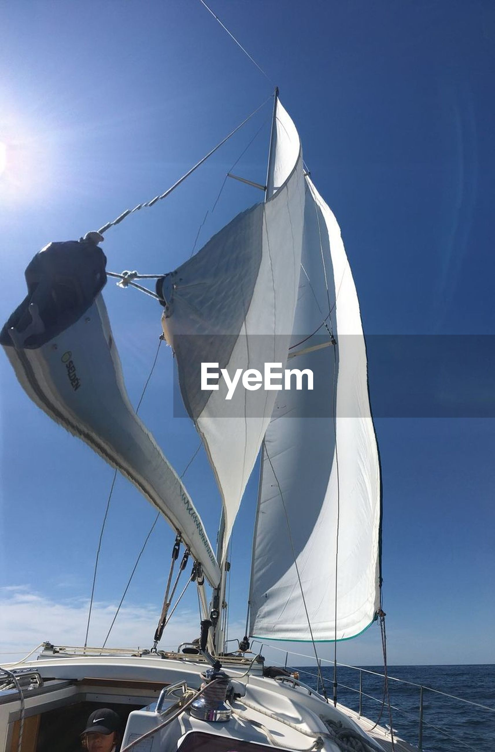 sky, transportation, nautical vessel, sailboat, mode of transportation, water, nature, mast, day, sunlight, sea, canvas, no people, blue, pole, low angle view, travel, sailing, outdoors, yacht