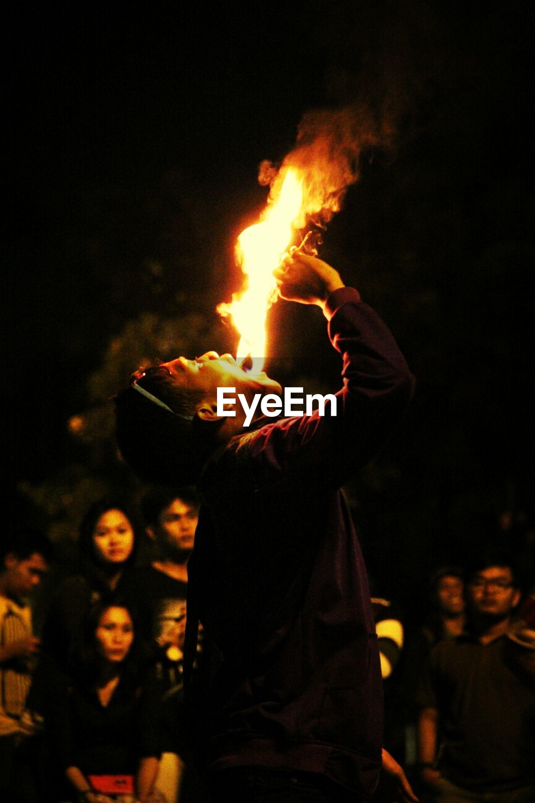 burning, flame, fire - natural phenomenon, night, heat - temperature, bonfire, glowing, fire, orange color, men, leisure activity, lifestyles, illuminated, heat, dark, campfire, outdoors, standing
