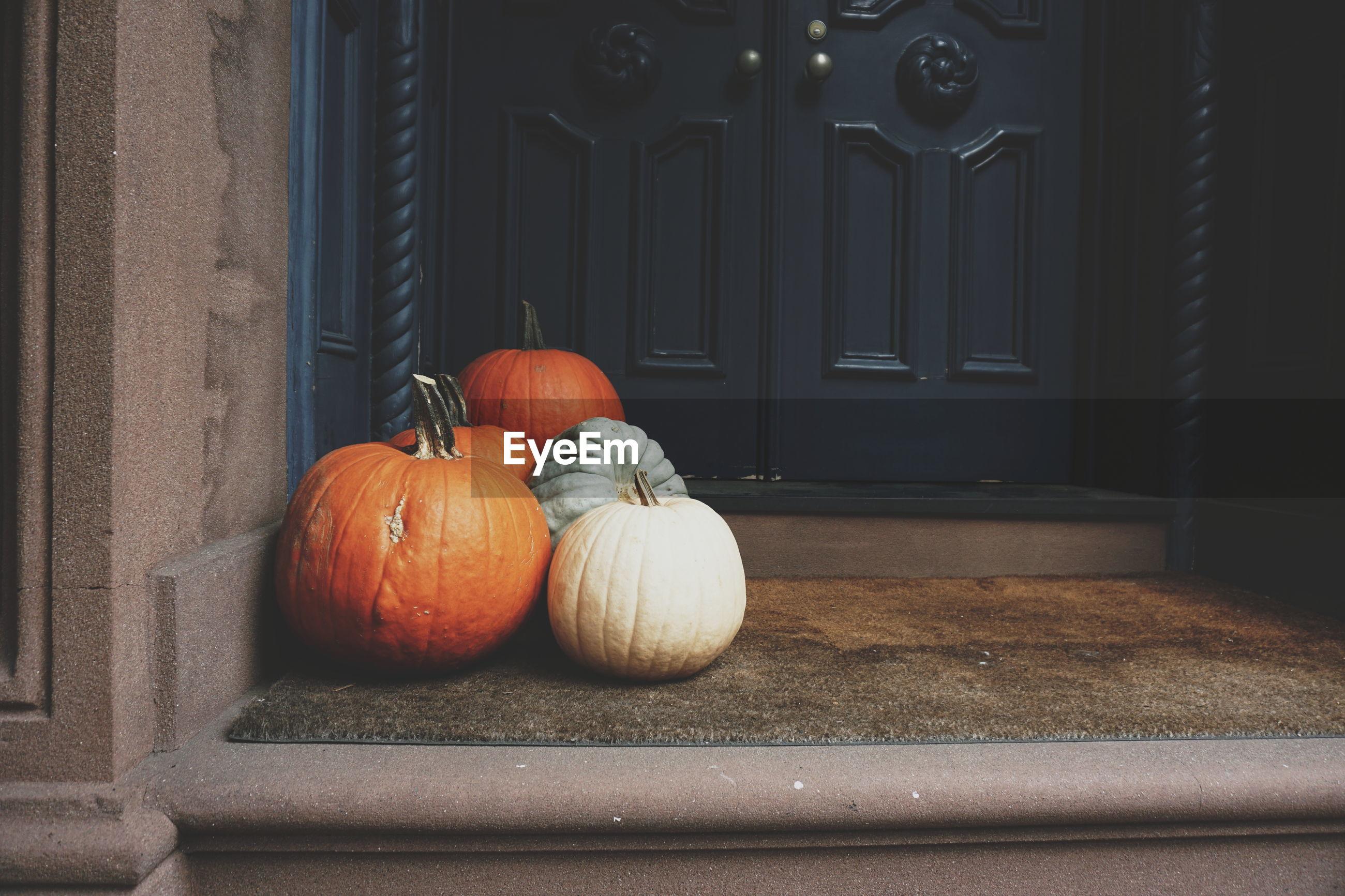 Close-up of pumpkins on porch