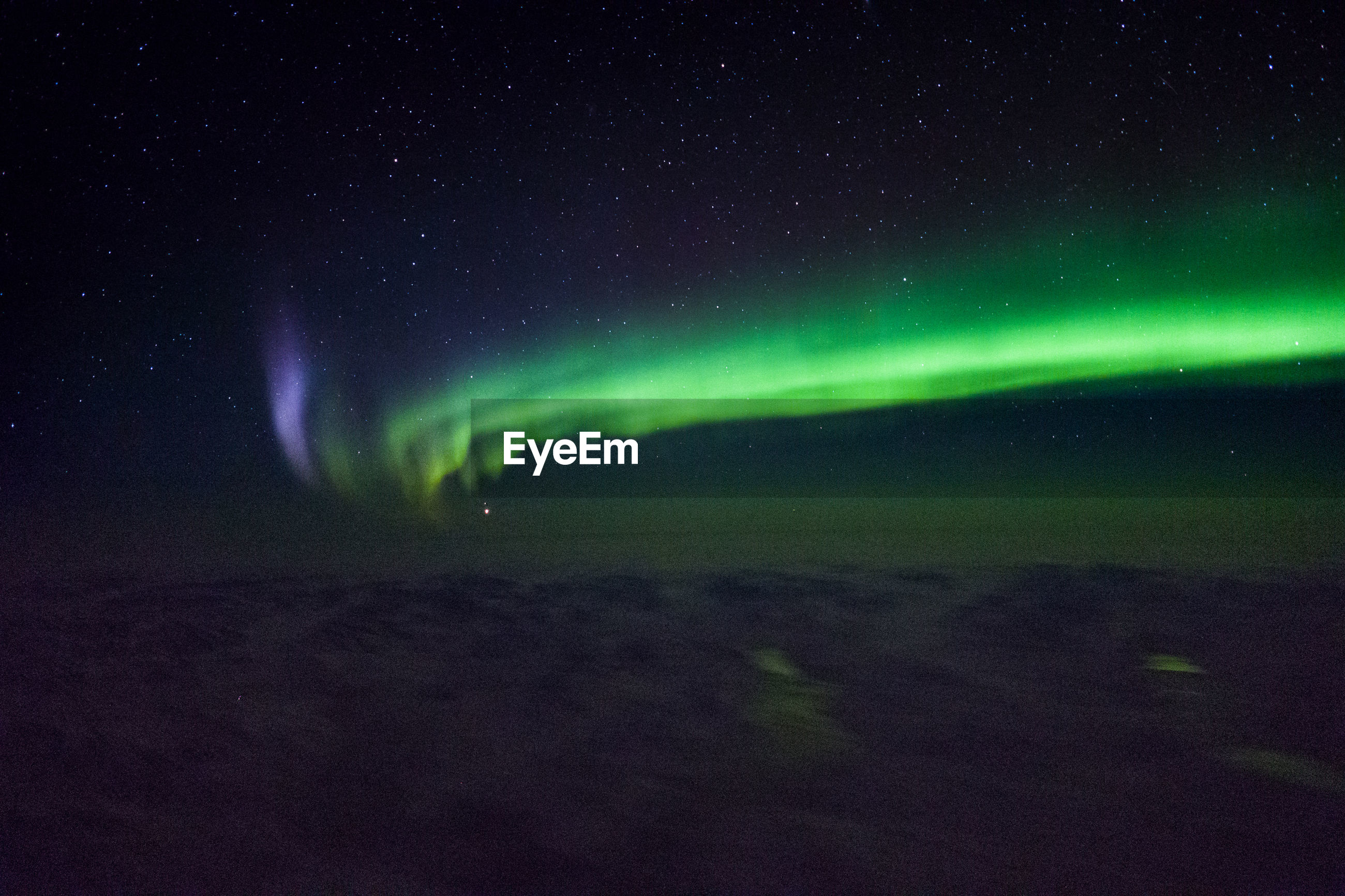 Low angle view of sky at night with northern lights