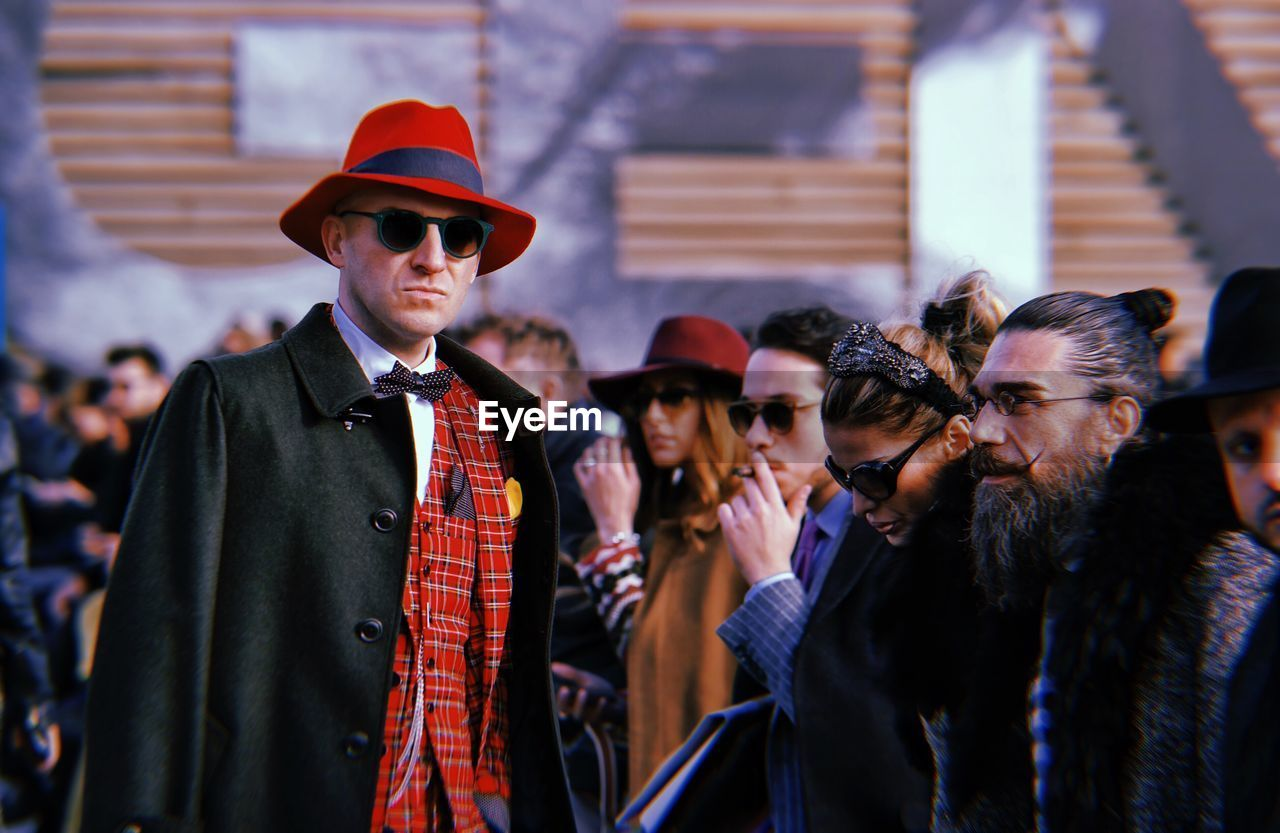 clothing, men, group of people, real people, adult, males, hat, standing, people, lifestyles, women, front view, waist up, leisure activity, togetherness, focus on foreground, performance, young men, fashion, teenager
