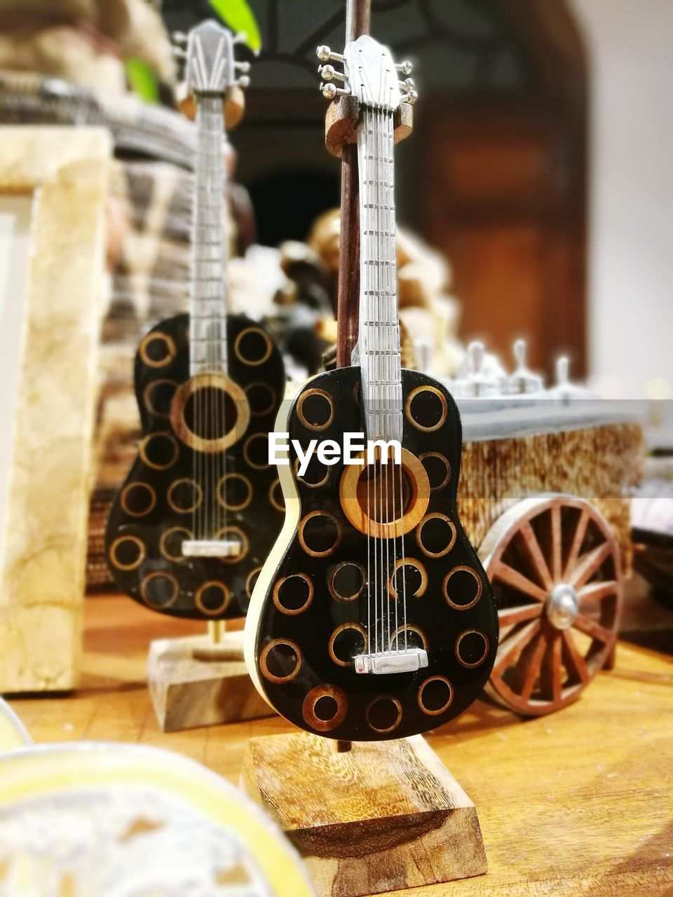 indoors, wood - material, no people, table, close-up, musical instrument, day