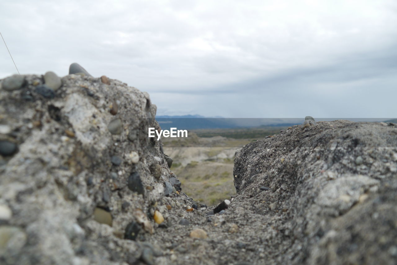sky, rock - object, cloud - sky, nature, day, outdoors, rough, no people, textured, close-up, scenics, beauty in nature