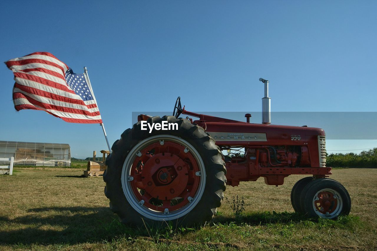 field, flag, patriotism, day, grass, outdoors, no people, red, clear sky, blue, landscape, nature, sky