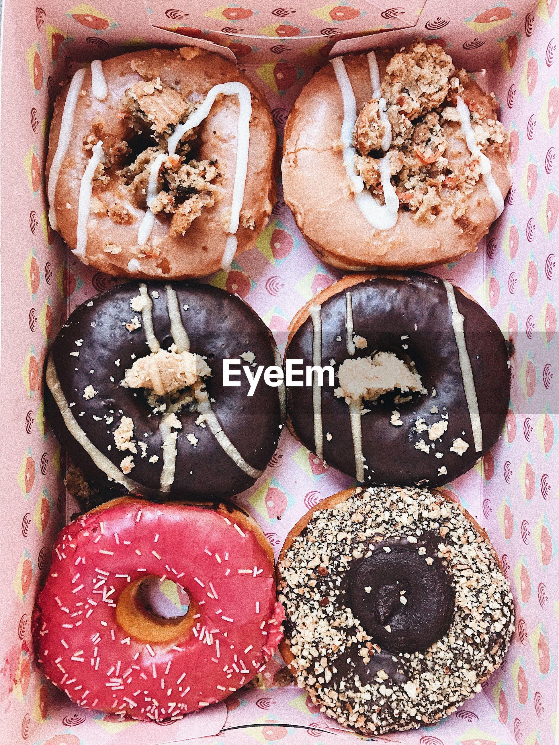 High angle view of chocolate doughnuts
