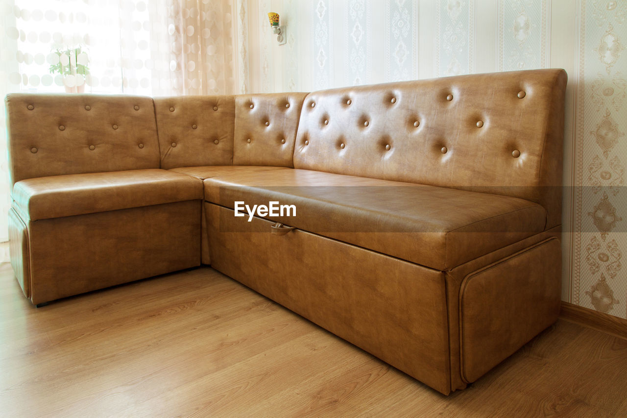 indoors, furniture, home interior, wood - material, no people, absence, sofa, domestic room, comfortable, empty, living room, wall - building feature, seat, flooring, architecture, wood, relaxation, chair, armchair, brown, luxury, cozy, clean