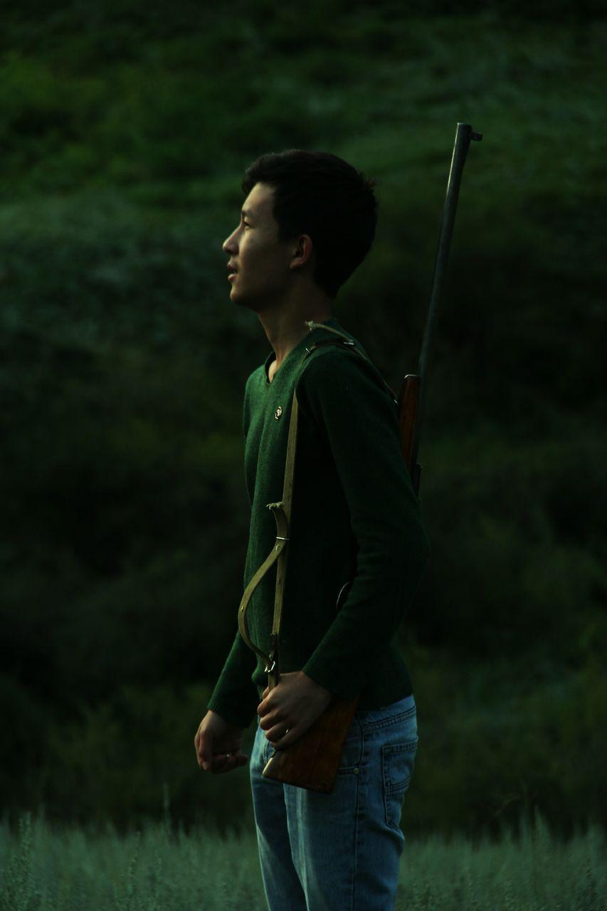 Full Length Of Man Standing On Grass