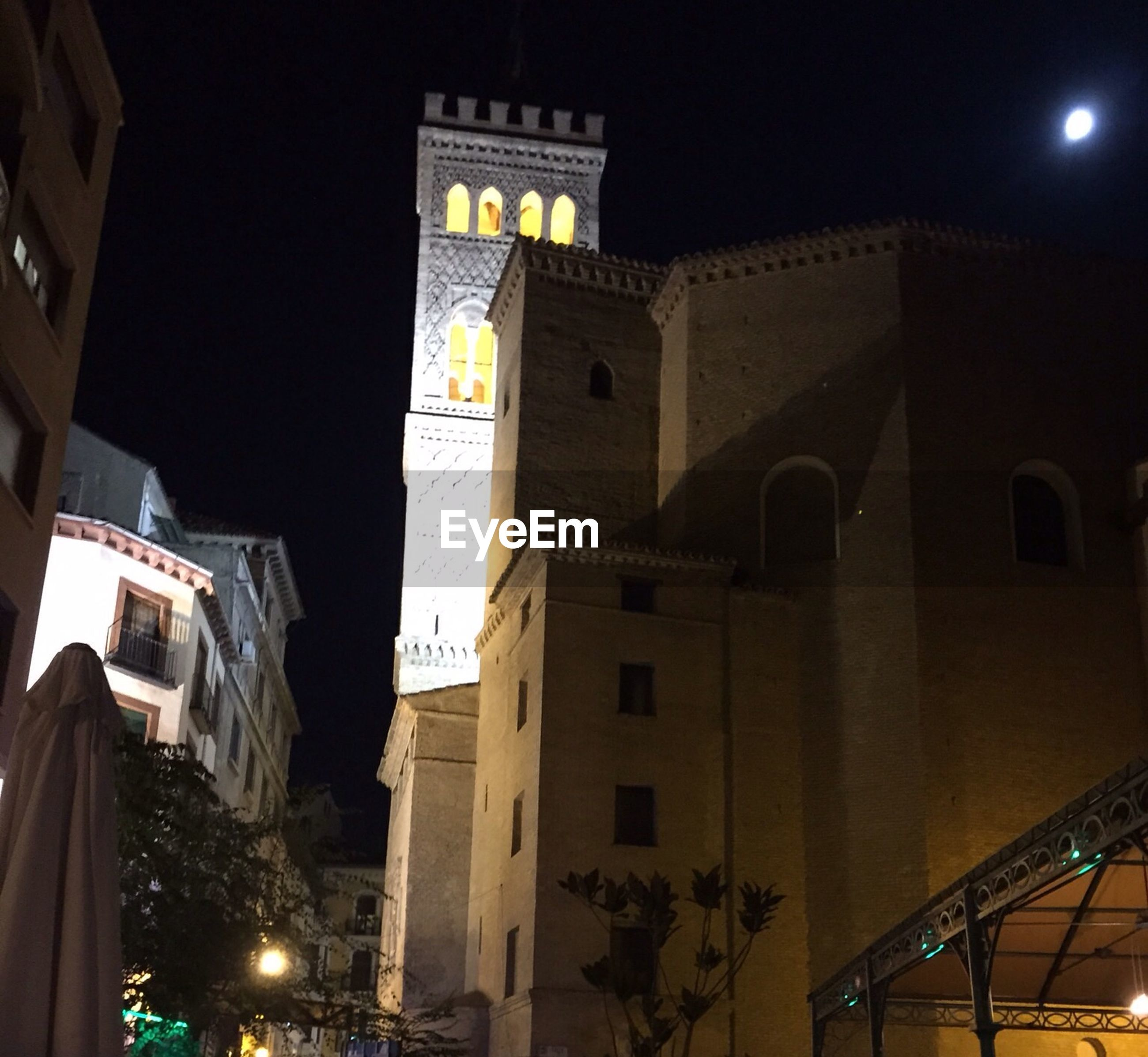 architecture, illuminated, night, building exterior, built structure, low angle view, street light, city, lighting equipment, building, clear sky, sky, light - natural phenomenon, city life, outdoors, residential building, street, travel destinations, no people, religion