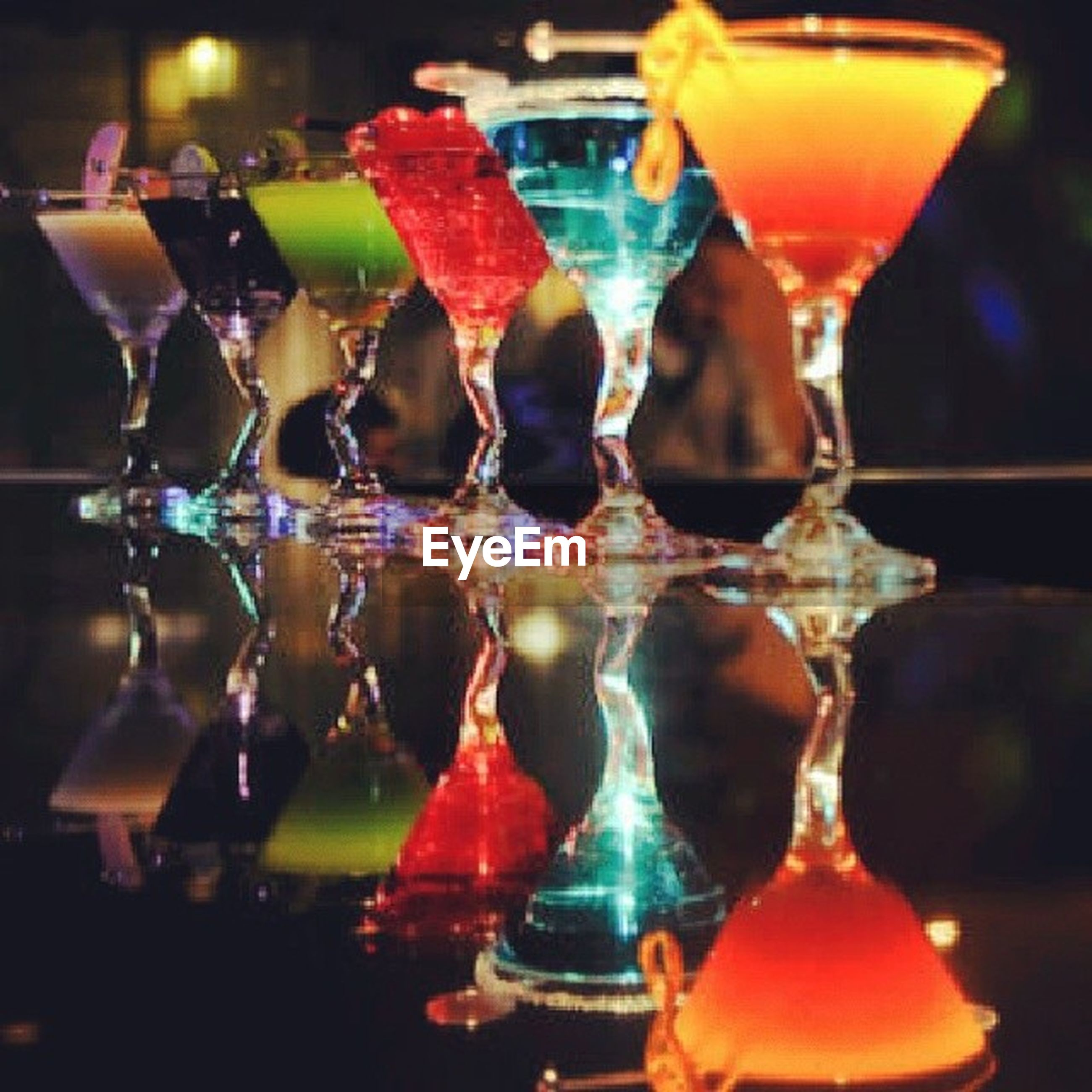 indoors, glass - material, multi colored, close-up, transparent, focus on foreground, still life, in a row, reflection, decoration, variation, hanging, celebration, selective focus, illuminated, colorful, drinking glass, glass, side by side, no people