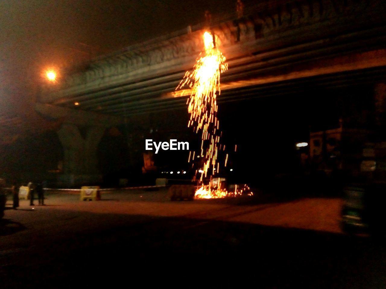 illuminated, night, glowing, burning, flame, celebration, firework - man made object, outdoors, long exposure, diwali, no people, sky