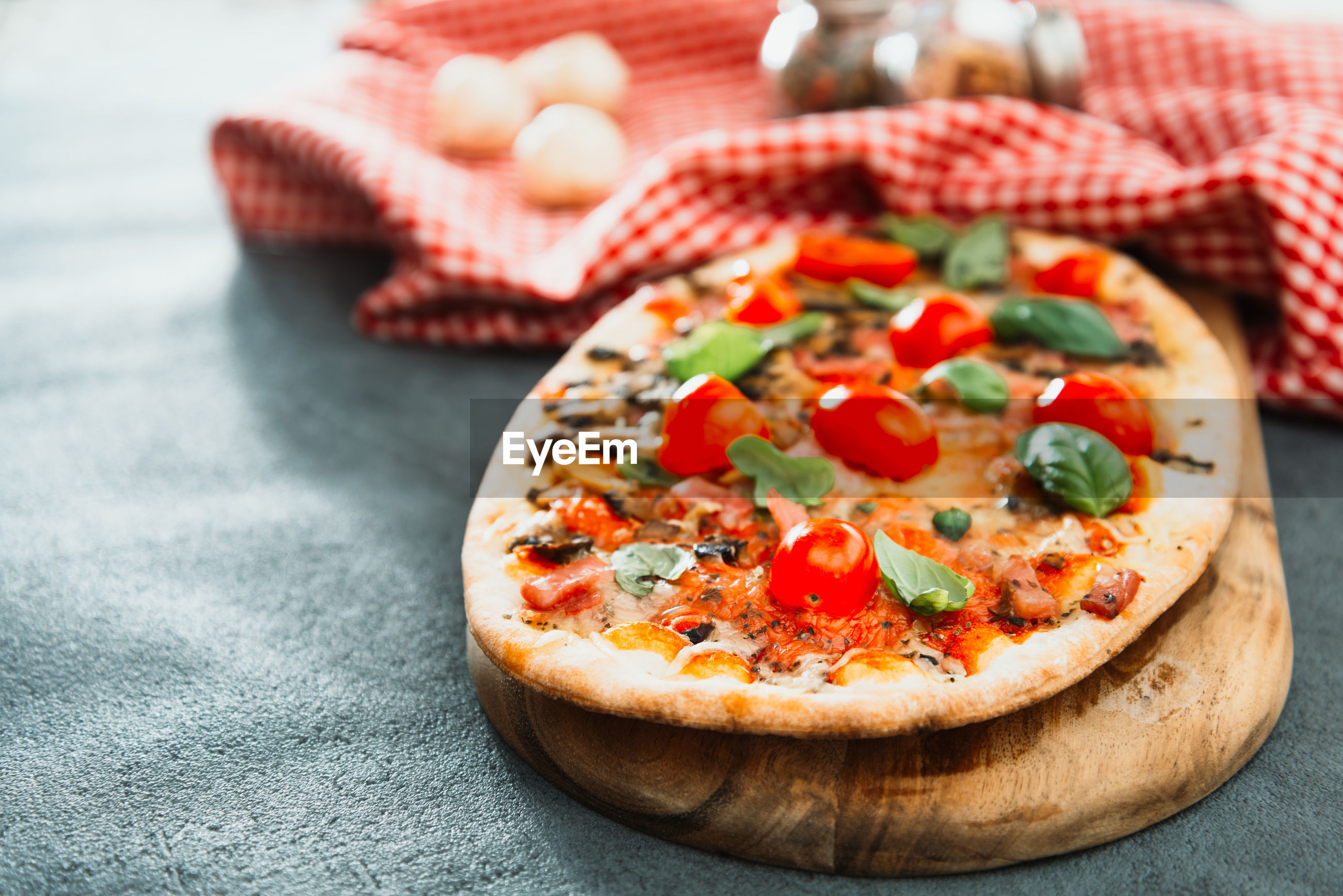 High angle view of pizza on serving board
